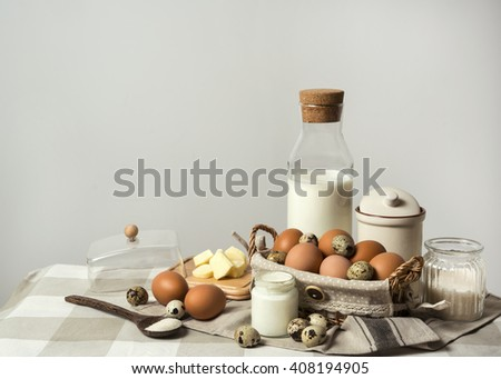 Dairy products on wooden table: eggs, quail eggs. Easter holiday concept.