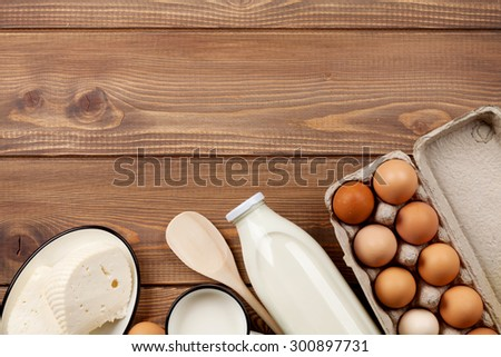 Dairy products on wooden table. Milk, cheese and eggs. Top view with copy space - stock photo
