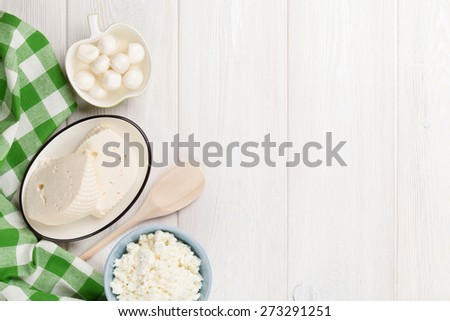 Dairy products on wooden table. Various cheese. Top view with copy space
