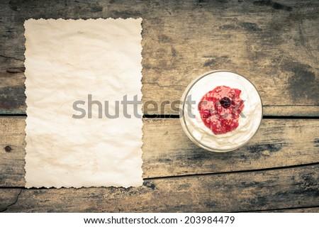 Dairy sweet dessert with raspberry jam and Fresh blueberry - stock photo