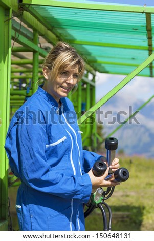 dairymaid at automatic milking system industry cow farm  - stock photo