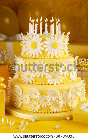 Daisy birthday cake with candles - stock photo