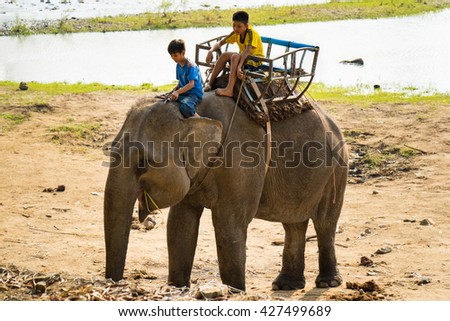 Dak Lak, Vietnam - Mar 29, 2016: Children ride elephant in Don village in Tay Nguyen, central highlands of Vietnam.