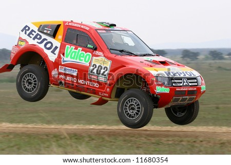 Dakar rally winner Luc Alphand jumping with Mitsubishi on Central Europe Rally.