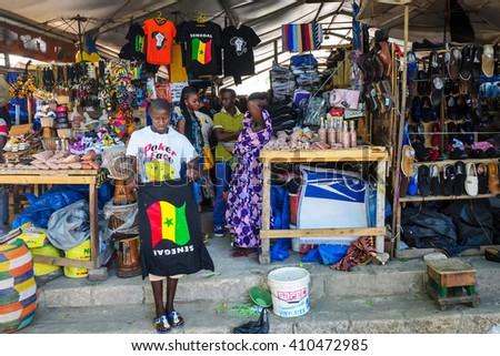 DAKAR/SENEGAL - NOVEMBER 11, 2013: Senegalese street bazaar in Dakar, Senegal - stock photo