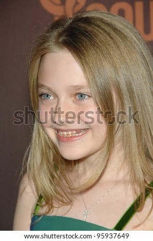 DAKOTA FANNING at the first CMT Giants concert honoring country star Reba McEntire, at the Kodak Theatre, Hollywood. October 26, 2006  Los Angeles, CA Picture: Paul Smith / Featureflash