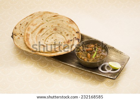 Dal Makhani with Paratha or Indian Bread - stock photo