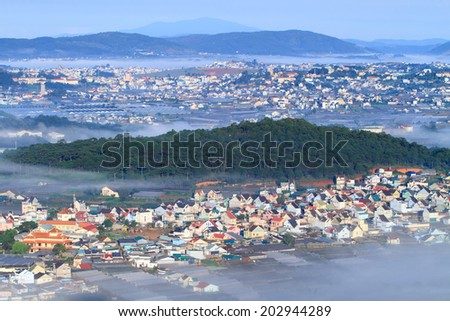 Dalat City in the morning, with cloud and fog- Viewing from the top - stock photo