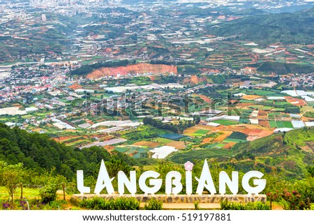 Dalat, Vietnam - August 2nd, 2016: Landscape mount Langbiang, below vegetable gardens, flower farming food supply for the whole region, place of excursions, central highlands near Dalat, Vietnam