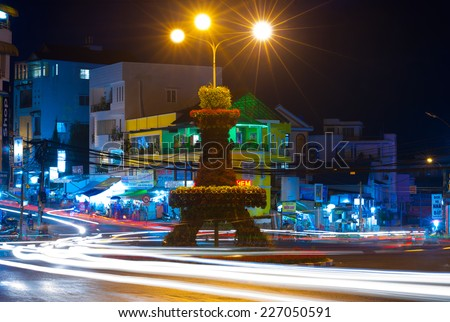 DALAT, VIETNAM - JULY 25, 2014: A night view at a tiny Eiffel Tower (flower bed) not far from the downtown. Dalat has several nicknames - little Paris of Asia is one of them. - stock photo