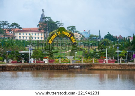 DALAT, VIETNAM - JULY 24, 2014: The main entrance of the Flower Park, one of major tourist attrations in the city. The arch consists of lots of flowers in pots settled on a metal frame.