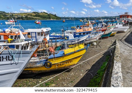 DALCAHUE, CHILE - MARCH 4, 2012: Colorful boats waiting in the pier during the weekend fair on Chiloe Island.