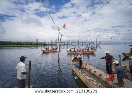 DALI, CHINA - MAY 16: People fishing on Erhai lake near Dali, Yunnan province, China on May 16 2014. Fishermen are Bai, a minority ethnic, and they use birds to fish. - stock photo