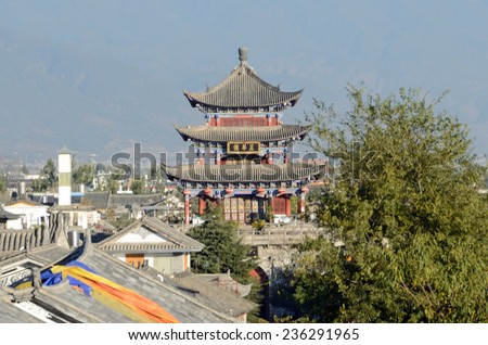 DALI, CHINA - NOVEMBER 25, 2014: Dali Ancient City was built in the second half of the fourteenth century and there are many Bai ethnic minority folk houses in old town. - stock photo