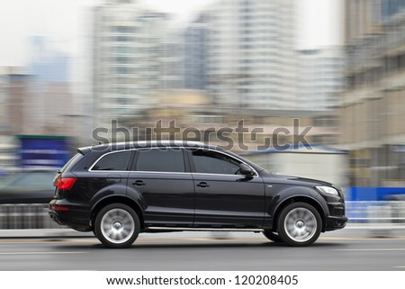 DALIAN-NOV. 22: Audi Q7 SUV rushing on the expressway. Thanks to a growth rate of 61.7 percent, last October turned out to be a new record month for Audi in China. Dalian, Nov. 22, 2012. - stock photo
