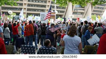 DALLAS - APRIL 15: A crowd gathers to protest big government and increased taxes in Dallas, Texas in front of City Hall on US Tax Day April 15, 2009. - stock photo