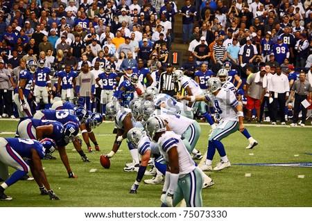 DALLAS - DEC 14:  Dallas Cowboys Quarterback Tony Romo points to a New York Giants defender as he calls signals. Taken in Texas Stadium on Sunday, December 14, 2008. - stock photo