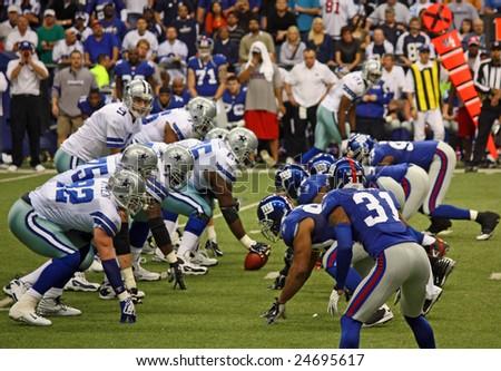 DALLAS - DEC 14: Dallas Cowboys Quarterback Tony Romo waits for the snap from the center during a game held Dec. 14, 2008 in Texas Stadium, Dallas, Texas. - stock photo