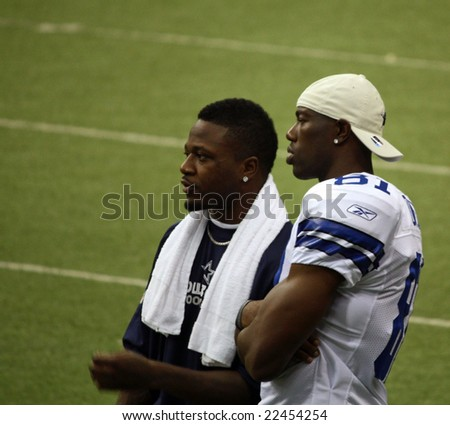DALLAS - DEC 14: Sunday, December 14, 2008. Dallas Cowboys receiver Terrell Owens on the sideline during a game with the NY Giants talking with Pacman Jones. Taken in Texas Stadium.