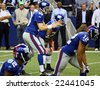 DALLAS - DEC 14: Taken in Texas Stadium on Sunday, December 14, 2008. NY Giants Quarterback Eli Manning prepares to receive the snap from center during a game with the Dallas Cowboys. - stock photo