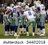 DALLAS - DEC 14: Taken in Texas Stadium on Sunday, December 14, 2008. Quarterback Tony Romo and the Dallas Cowboys in the huddle in a game against the NY Giants. - stock photo
