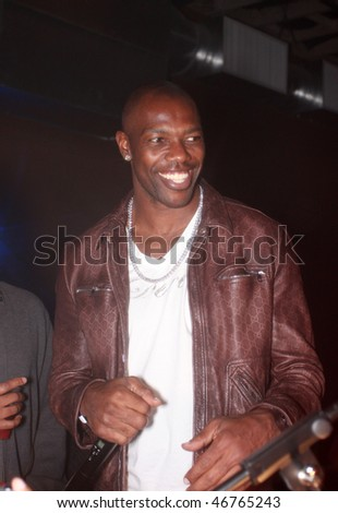 DALLAS - FEBRUARY 14: Buffalo Bill's receiver Terrell Owens interacts with the crowd at an event he hosted during NBA All Star weekend February 14, 2010 in Dallas, Texas. - stock photo