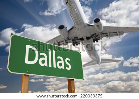 Dallas Green Road Sign and Airplane Above with Dramatic Blue Sky and Clouds. - stock photo