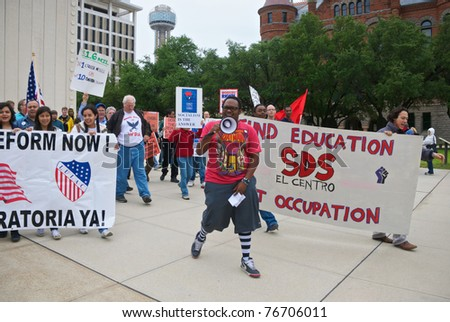 DALLAS - MAY 1: Student Deante Toombs leads a May Day rally as it departs from the JFK Memorial in downtown Dallas, Texas on May 1, 2011. May Day is generally considered a day to promote socialism. - stock photo