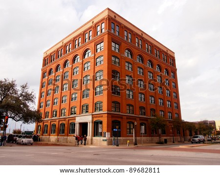 DALLAS - NOV 25: Tourists visit the Sixth Floor Museum, November 25, 2011, in Dallas, Texas. The museum about the Kennedy Assassination draws 325,000 visitors annually. - stock photo