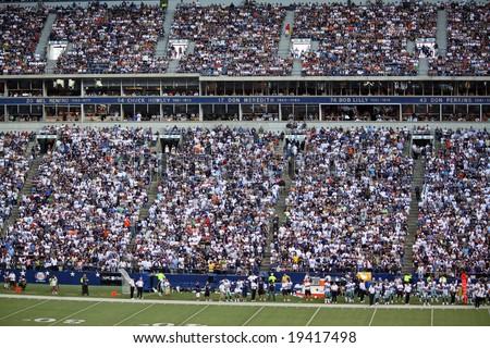 DALLAS - OCT 5: Texas Stadium Irving, Texas on Sunday, October 5, 2008. Dallas Cowboys fans, the sideline and Texas Stadium Ring of Honor. Last season Cowboys will play in Texas Stadium. - stock photo