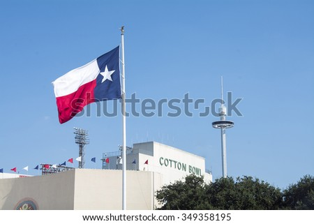 Dallas - October 11: In front of Cowboy Stadium, Dallas, TX., on Sunday, october 11, 2015. The historic cotton bowl stadium and texas state flag viewed from the fair grounds  - stock photo
