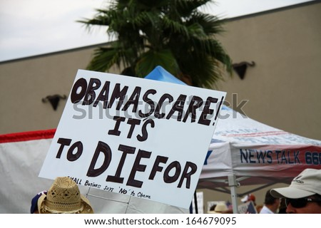 DALLAS - SEP 04 : An Obamacare protest sign at the Tea Party Express conservative political rally in Dallas. Taken September 04, 2009 in Dallas, TX. - stock photo