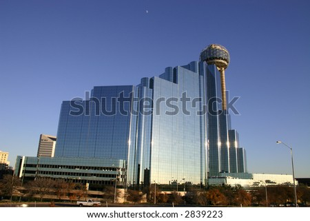 Dallas skyline and moon against blue sky at sunset - stock photo