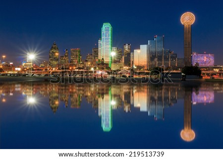 Dallas skyline reflected in Trinity River at sunset, Texas - stock photo