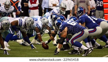 DALLAS, TEXAS - DECEMBER 14, 2008: Eli Manning and the NY Giants lineup against the Dallas  Cowboys in the Texas Stadium. - stock photo
