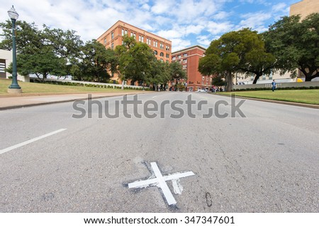 "DALLAS, TEXAS, USA - NOV 9: The ""X"" that marks the spot where President John F. Kennedy was assassinated on November 9, 2015. The landmark is by the grassy knoll in Dealey Square.   - stock photo"