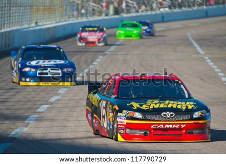 DALLAS, TX - NOVEMBER 04:  Clint Bowyer 15 leads Brad Keselowski at the Nascar Sprint Cup AAA Texas 500 at Texas Motorspeedway in Dallas, TX on November 04, 2012