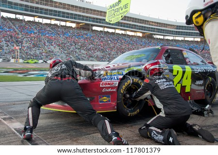 DALLAS, TX - NOVEMBER 04: Jeff Gordon tire change during at pit stop at the Nascar Sprint Cup AAA Texas 500 at Texas Motorspeedway in Dallas, TX on November 04, 2012 - stock photo