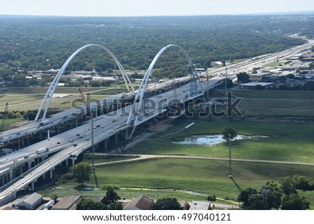 DALLAS, TX - SEP 17: Margaret McDermott Bridge from the Reunion Tower Observation Deck in Dallas, Texas, on Sep 17, 2016. It is a steel suspended arch bridge under construction over the Trinity River.