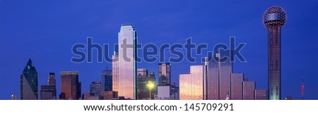 Dallas, TX skyline at night with Reunion Tower - stock photo