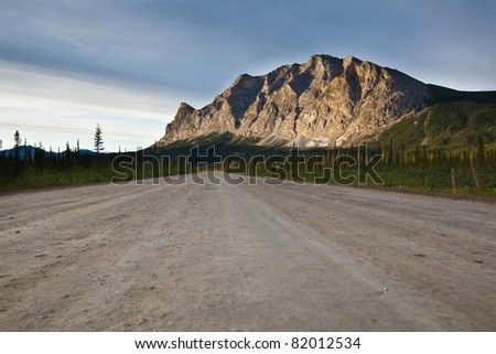 Dalton highway with mountain from Brook range in Alaska - stock photo