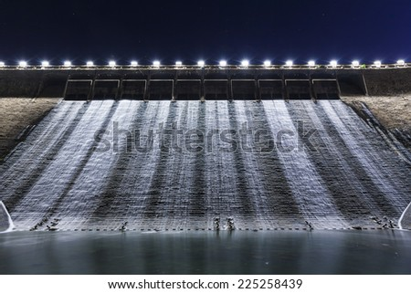 Dam at night - stock photo