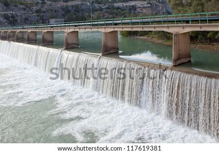 dam construction on river - stock photo