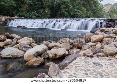 Dam handmade with stones A small river - stock photo