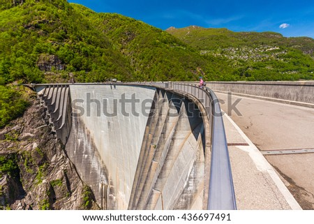 Dam of Contra Verzasca Ticino, Switzerland. The dam creates a water reservoir Lago di Vogorno. It is famous place for bungee jumping and place where some scenes of James Bond movie was taken place.  - stock photo
