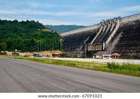 Dam, road, blue sky and tree at Nakhonnayok province