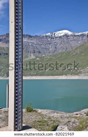 Dam water level measurement. Moncenisio dam, Italy/France border. Meter used to measure the level of water. - stock photo