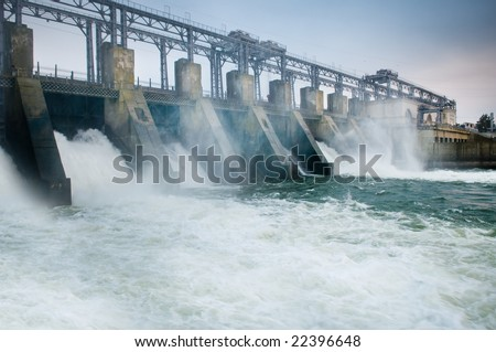 Dam with flowing water - stock photo
