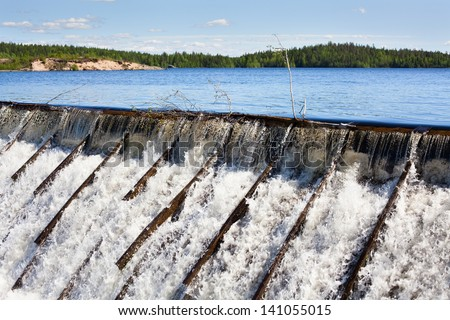 Dam with wooden needle in Russia - stock photo