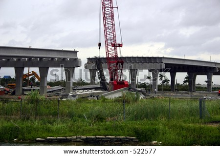 Damage by hurricane Katrina: An overpass under construction collapsed Thursday, Aug. 25, 2005, in Miami Florida. - stock photo